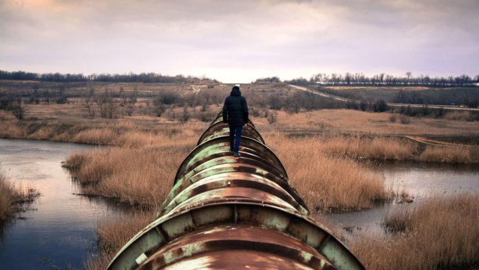 Person walking on oil pipeline